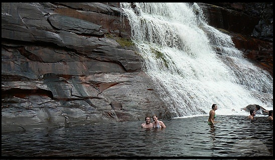 swimming at the base of the falls canaima national park
