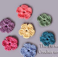 http://www.ravelry.com/patterns/library/pretty-flowers-applique