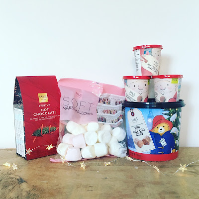 Hot chocolate, marshmallows, yule logs and chocolate buttons to enjoy snuggled up with a book or Christmas film