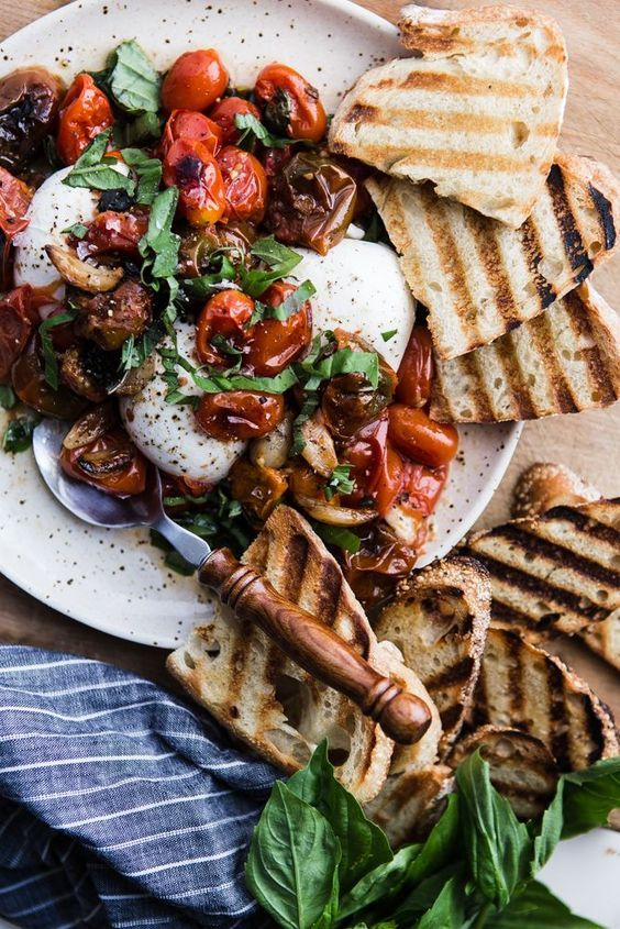 Braised Tomatoes with Burrata   Nothing compares with the sweet flavor of vine ripened cherry tomatoes except vine ripened cherry tomatoes that are braised and served warm over creamy burrata.