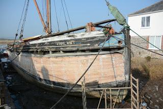 Thames barge The Vigilant under restoration at Topsham Quay