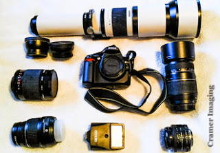 Photograph of Cramer Imaging's first professional level DSLR camera gear including several lenses, a camera body, and a flash