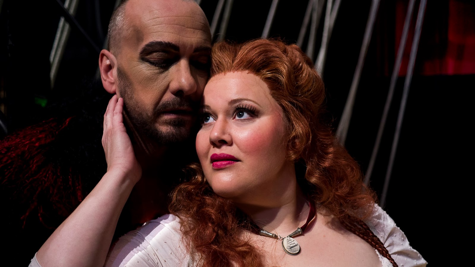 IN PERFORMANCE: Bass-baritone WAYNE TIGGES as Der Holländer (left) and soprano CHRISTINA PIER as Senta (right) in Virginia Opera's production of Richard Wagner's DER FLIEGENDE HOLLÄNDER, April 2016 [Photo by Lucid Frame Productions, © by Virginia Opera]