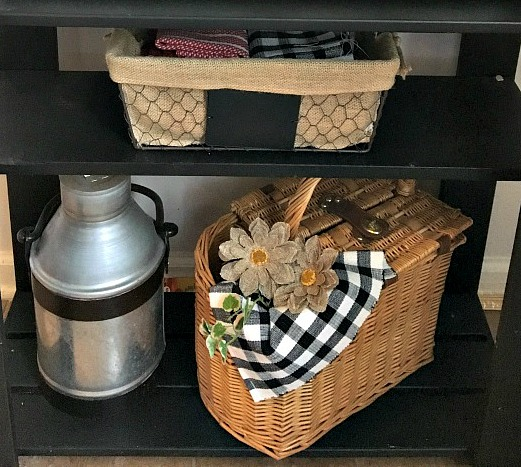 Vintage, Paint and more... burlap lined wire basket with cloth napkins, galvanized milk can, wicker picnic basket with burlap flowers make a pretty little shelf vinette