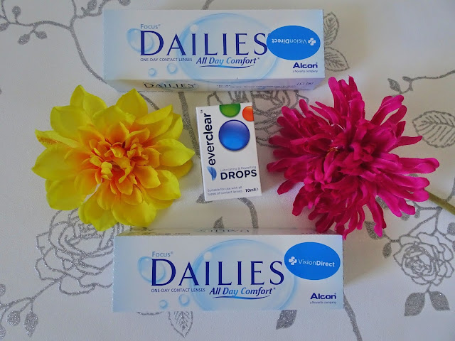 flatlay of contact lenses with bright flowers