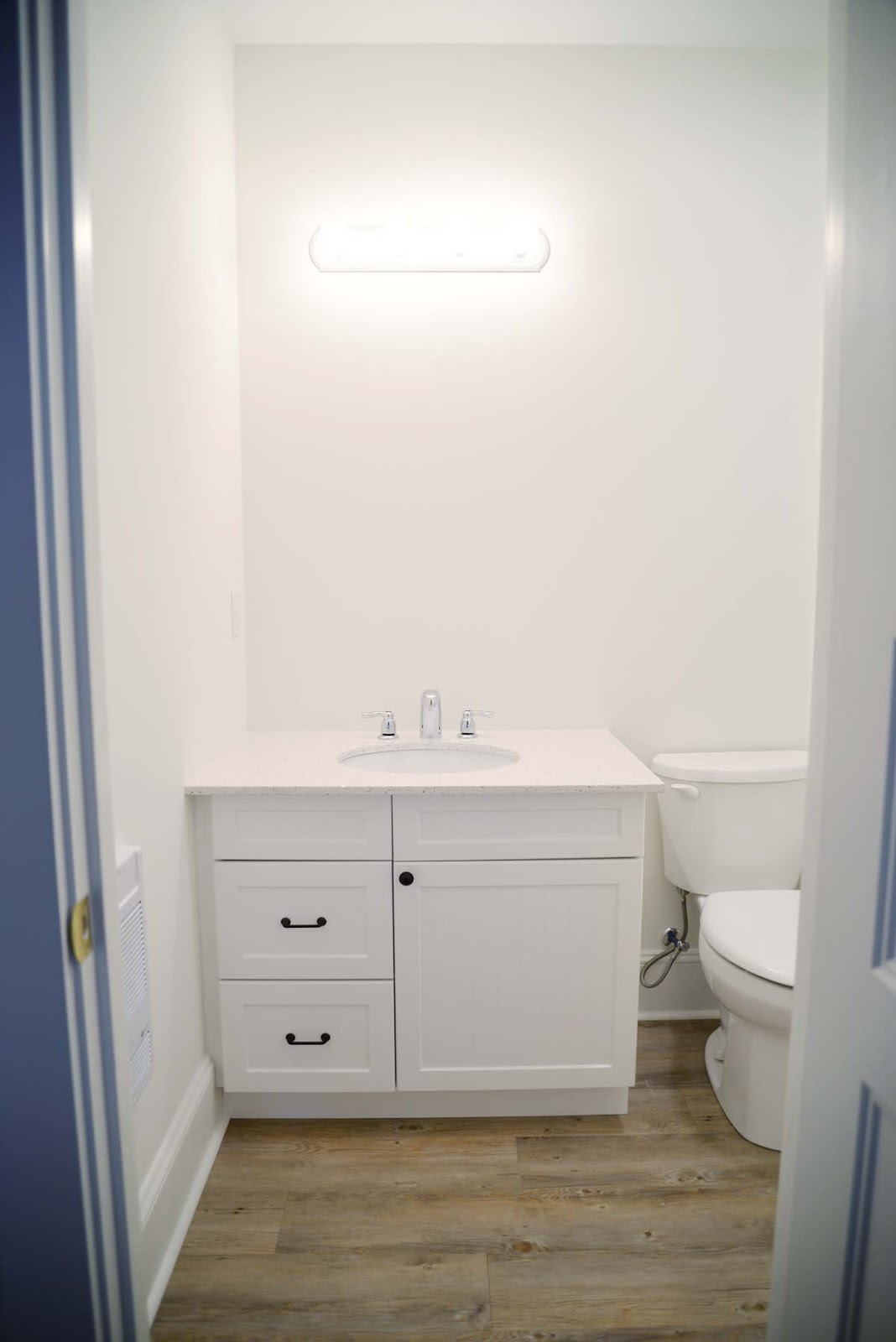 white cottage beachy bathroom | beadboard cabinet