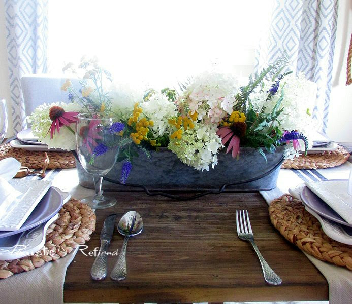 A quick and easy table set for family and friends using fresh cut flowers for a pretty farmhouse tablescape.
