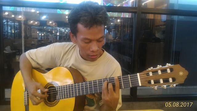 gitar dan masyarakat batak