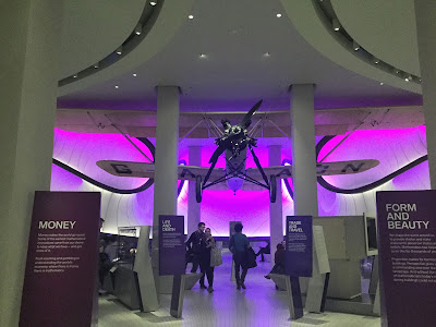 Pic of entrance to gallery with purple light and plane overhead
