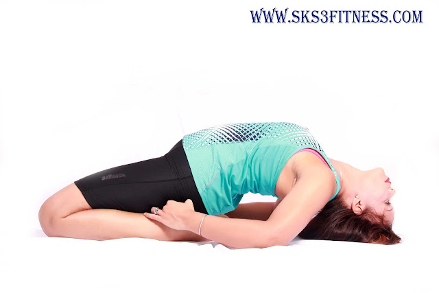 A girl doing Supta Vajrasana Benefits Yoga Reclined Thunderbolt Pose