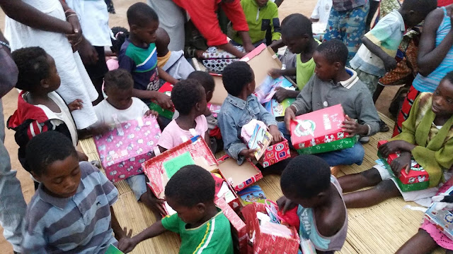 Children checking out their Operation Christmas Child shoeboxes in Zambia.