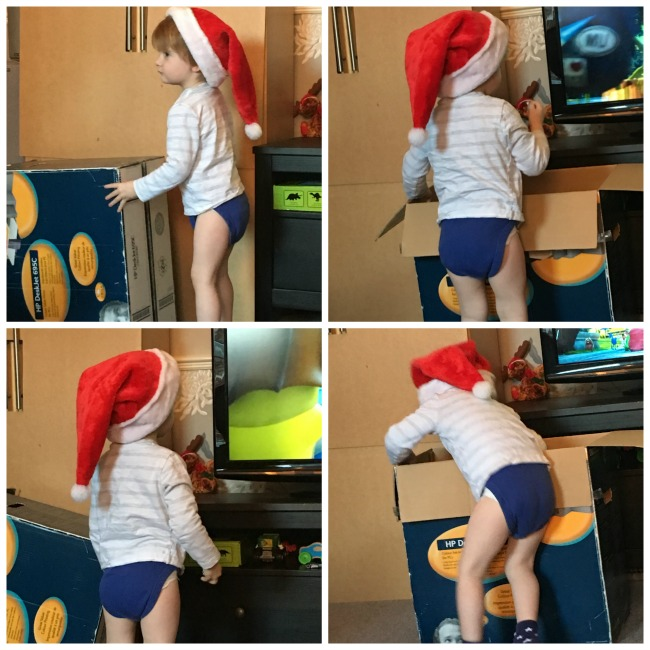 Our-weekly-journal-9th-Jan-2017-toddler-in-christmas-hat-putting-decorations-into-box
