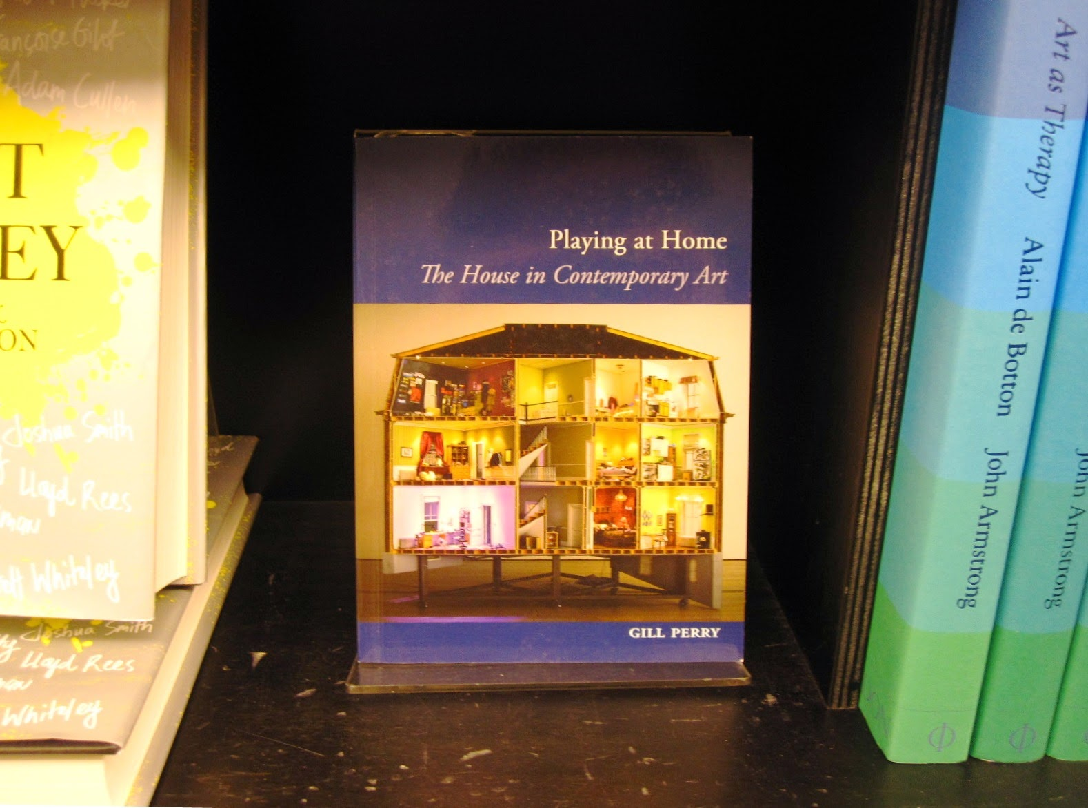 The book 'The house as contemporary art' on display in a shop.