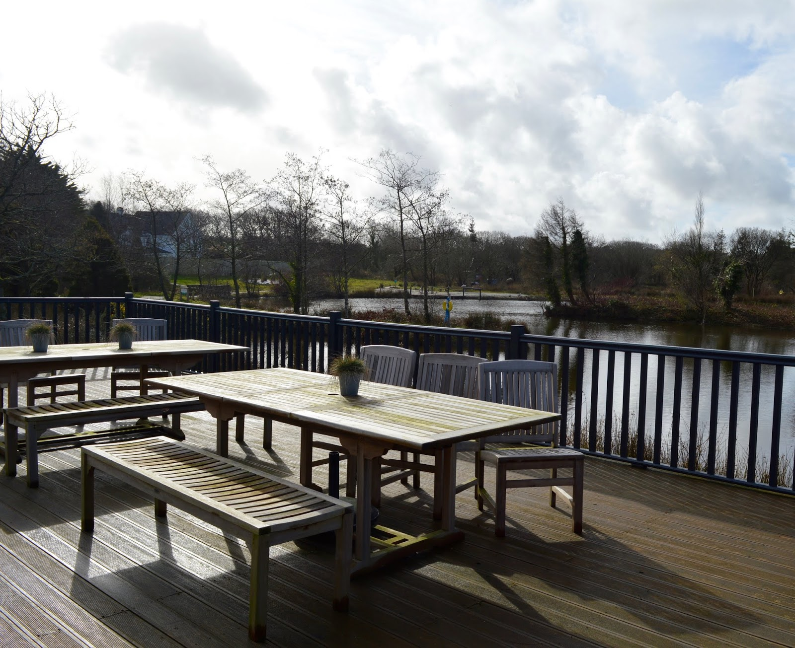 Waterside Cornwall Review | Self-Catering Lodges Near The Eden Project - terrace overlooking lake