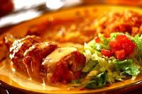 Receta fácil de Pechugas y muslos de pollo rellenas al horno