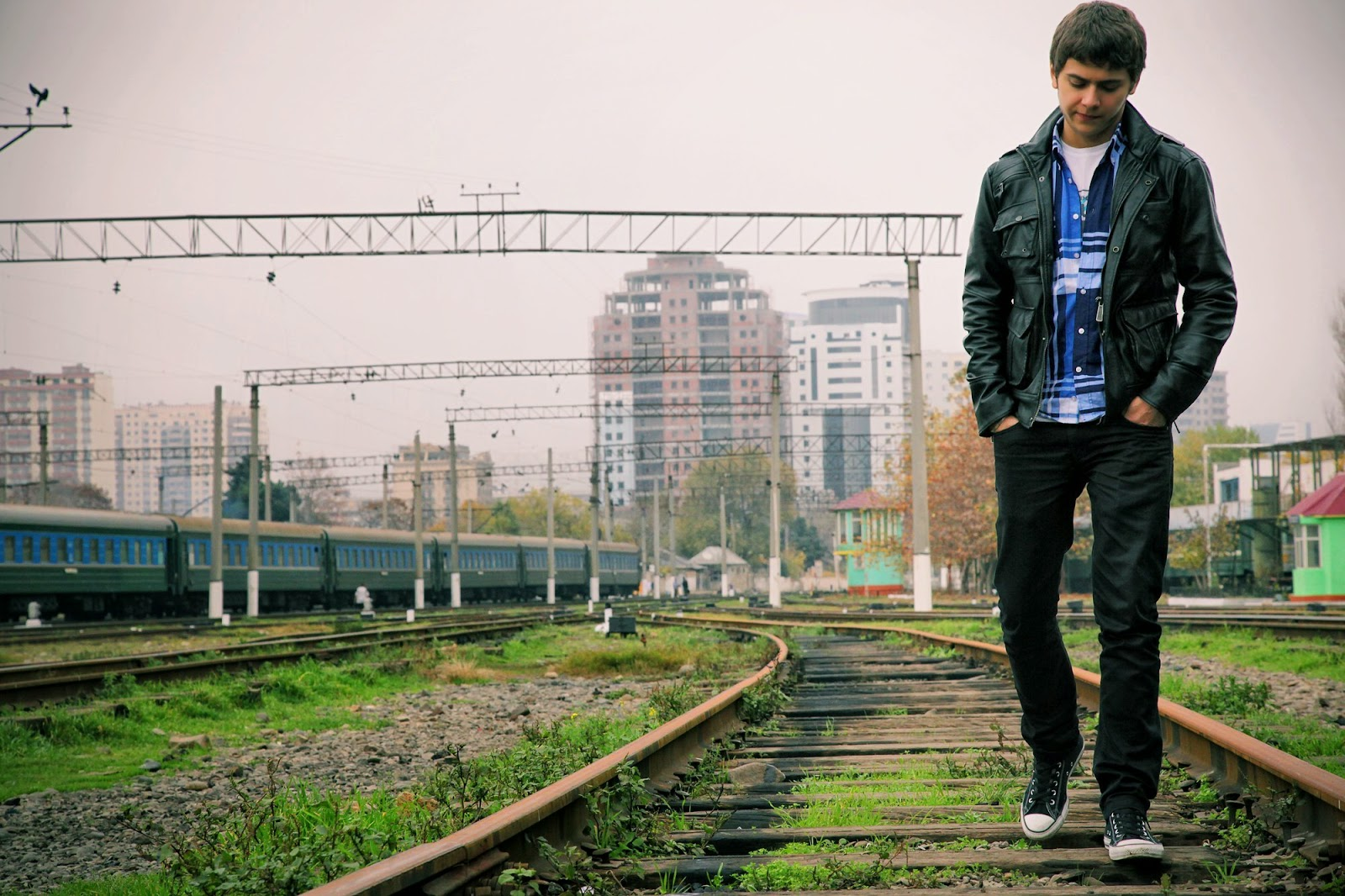 boy in love walking in railway track