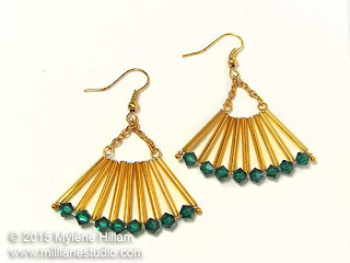 Art Deco inspired, fan-shaped earrings in Emerald and gold earrings featuring long gold bugle beads