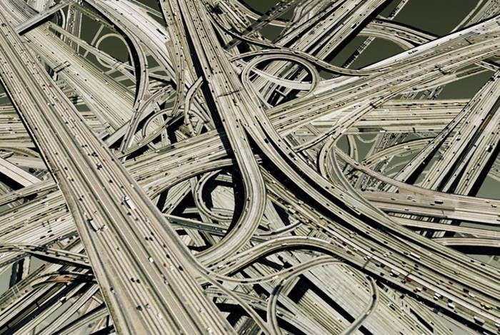 The imagination of German photographer Hubert Blanz in a series of images called Roadshow, featuring entwined interchanges that look like spaghetti junctions on steroids.