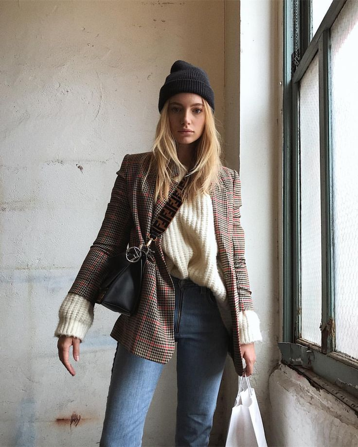 How to Master the Layered Blazer Look for Winter — Model Maya Stepper Outfit Idea With a Black Beanie, Plaid Blazer, Beige Sweater, Fendi Bag, and Jeans