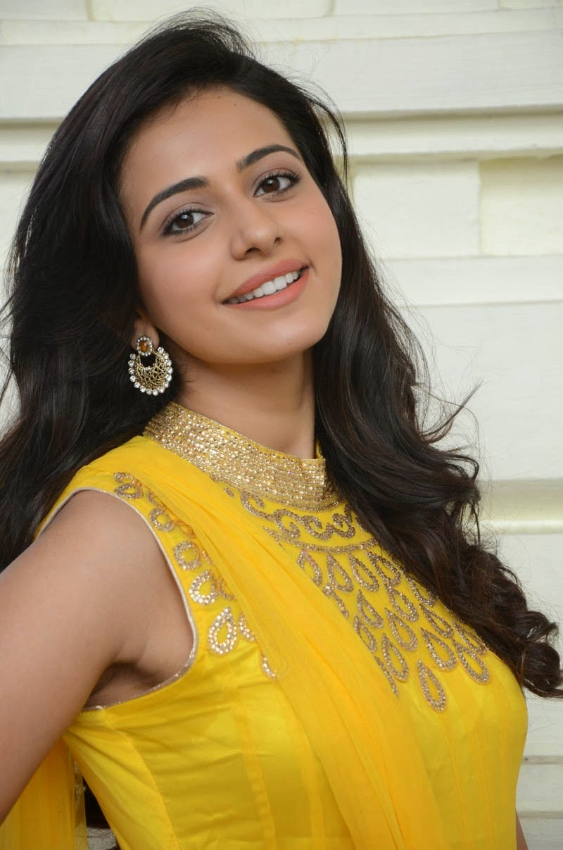Actress Rakul Preet Singh Cross Legs Photos In Grey Dress  ❤ ❤  ❤