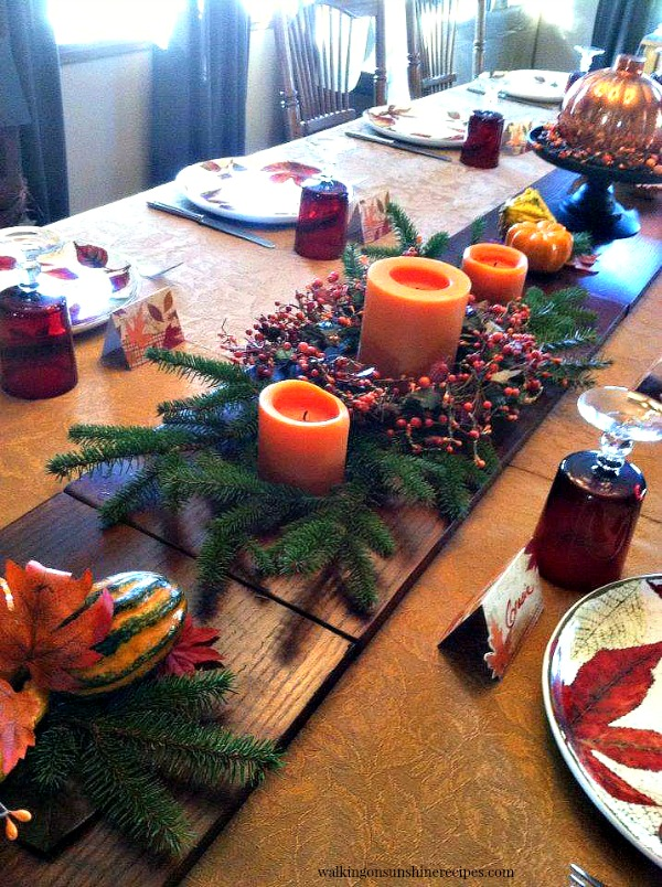 Thanksgiving Table  closeup of centerpiece using bookshelves as a table runner  from Walking on Sunshine Recipes