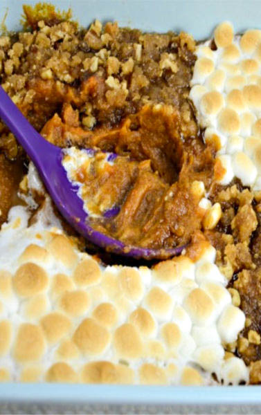 His and Her Sweet Potato Casserole, two Thanksgiving traditions come together, toasted marshmallows and pecan crumble toppings blanketing creamy smooth sweet potatoes.  Scrumptious!!