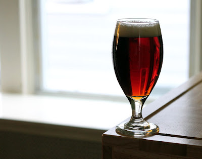 Glass of sour-cherry whisky-barrel-aged brown ale!