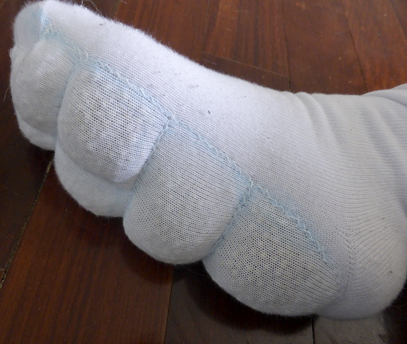 Completed sock being worn