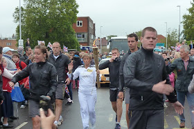 Olympic flame passing through Worthing 2012