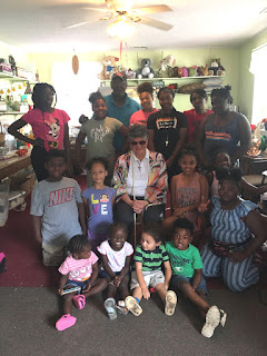 Laurel with Mr. Kelvin King and summer day campers at Pink House Neighborhood Resource Center.