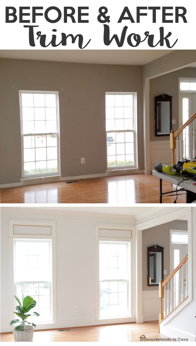 window and door trim as well as crown molding and higher baseboards in living room