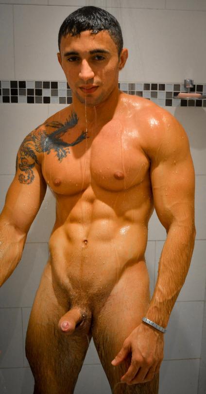Muscle jock taking a shower