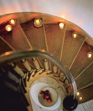 Lining your staircase with candles is a fun and romantic way to decorate.