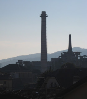 The chimneys of the cement factory are still a  feature of the Tregnano skyline