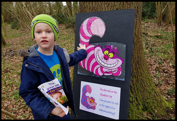 Playing pin the tail on the Cheshire Cat