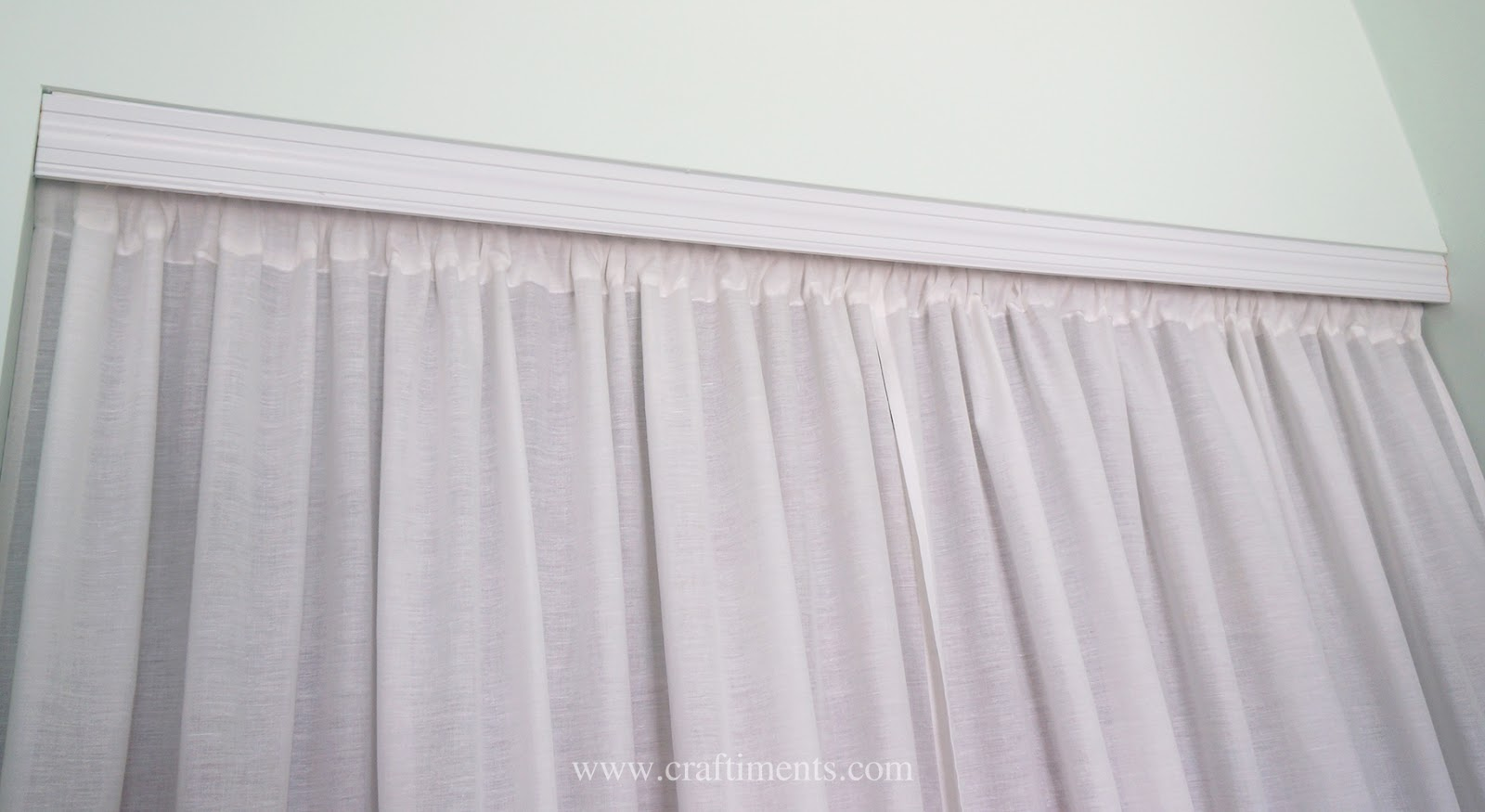 A casing is sewn into twin bed sheets to create curtains that replace sliding closet doors.