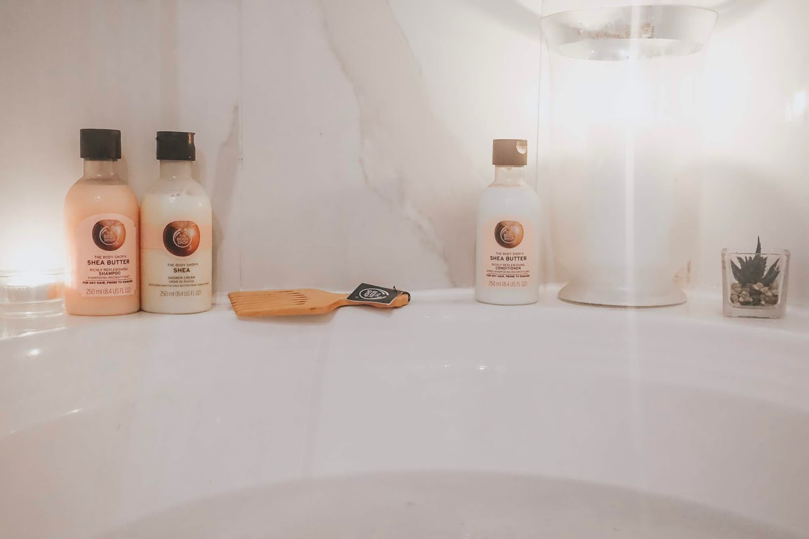 The Body Shop Shea Shampoo and Conditioner in a relaxing bath