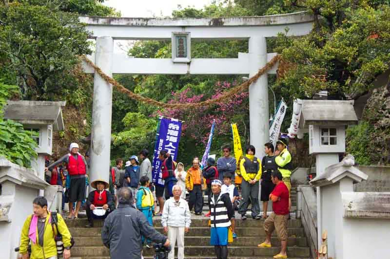 crowd and view of torii at Hakugindo Shrine, Itoman, Okinawa