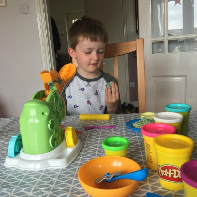 boy-playing-with-playdoh