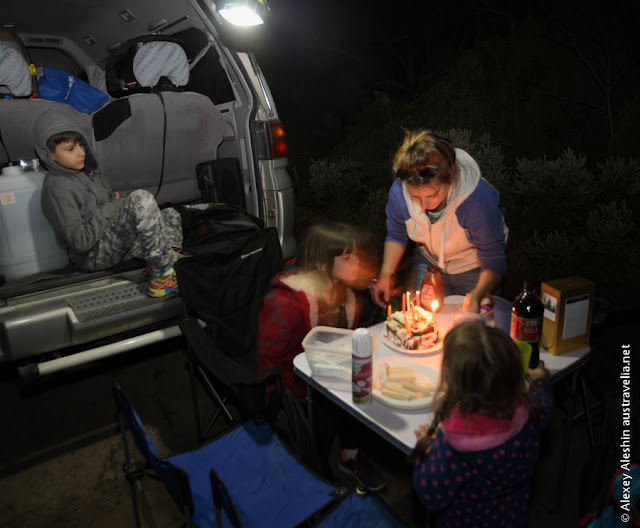 Blowing birthday cake candles at the campground