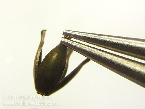 Curling the tips of the tulip bead caps