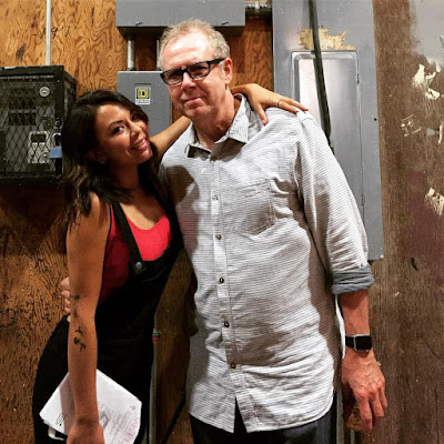 PLL Janel Parrish and Norman Buckley behind-the-scenes set photo 7x12