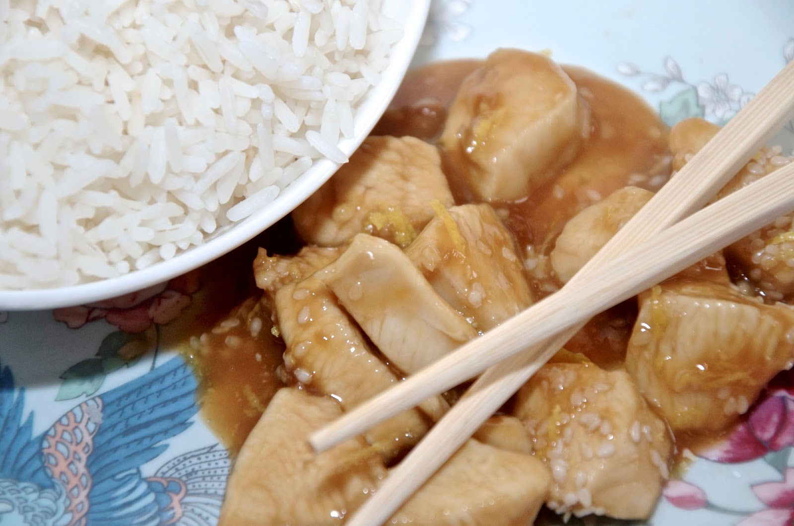 asian chicken, rice and chopsticks