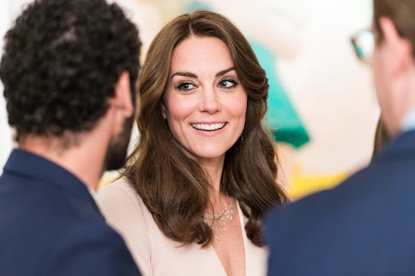 Kate Middleton visits the 'Vogue 100' exhibition. Kate Middleton wore her Alexander McQueen Wool and Cashmere Blend Dress