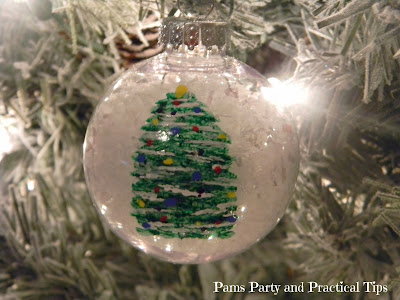 Painted Christmas tree ornament hanging in a tree