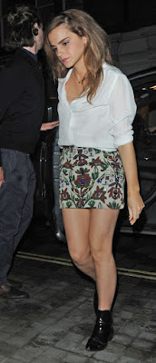 Emma Watson shows off legs in a floral mini skirt in London
