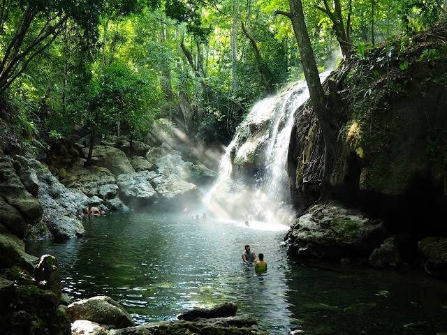 Natural hot springs waterfall near Rio Dulce, Guatemala