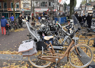 Many bicycles, including one with two child seats and panniers, Zaandam, The Netherlands