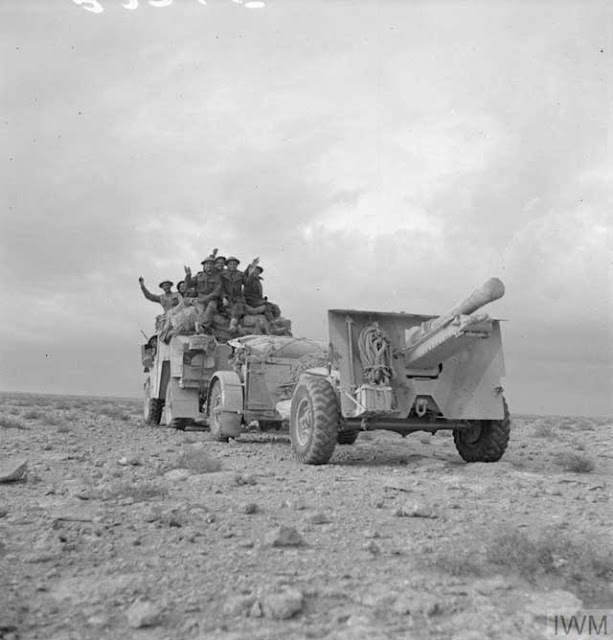 A Quad artillery tractor towing a 25-pounder gun, 22 December 1941 worldwartwo.filminspector.com