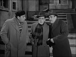 Peppino de Filippo, right, with Totò, centre, in a scene from their 1956 movie, La Banda degli Onesti